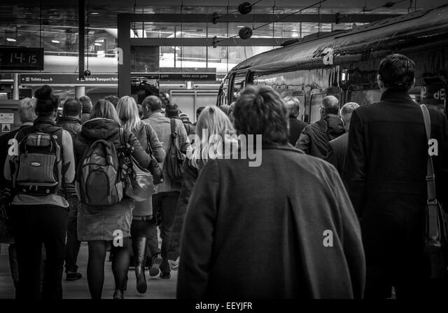 People viewed from behind in a station - Stock-Bilder