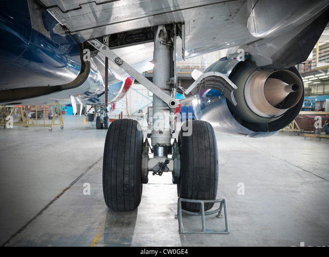 Close up of airplane wheels in hangar - Stock Image