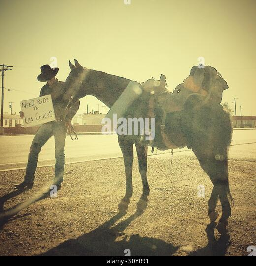 Cowboy and horse - Stock Image