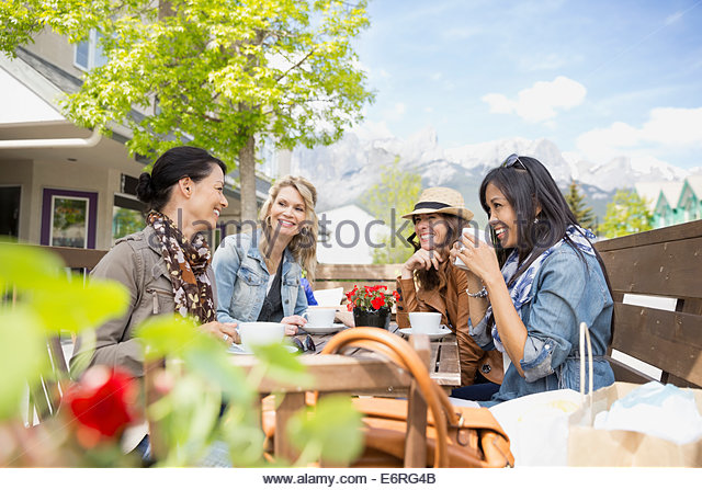 Women eating together at cafe - Stock Image