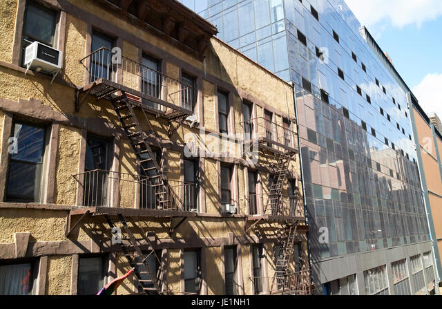 contrasting 19th century and 21st century residential architecture New York City USA - Stock Image