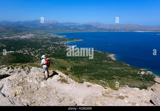 Trekker contemplating the view from Atalaya de Alcudia. Mallorca Island. Spain - Stock Image