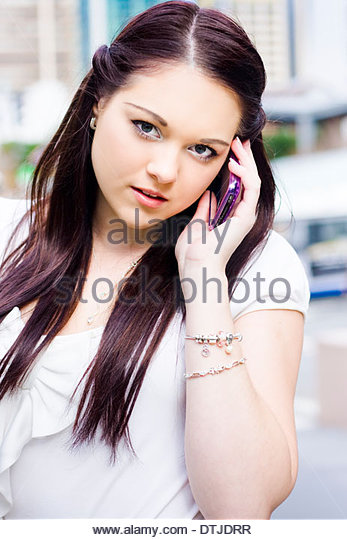 Cute Saleswoman Or Sales Woman With Brunette Hair Selling A Business Deal To A Corporate Telecommunication Firm - Stock Image