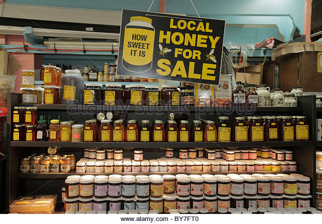 Philadelphia Pennsylvania Reading Terminal Market downtown farmers market local food Artisanal honey vendor for - Stock Image