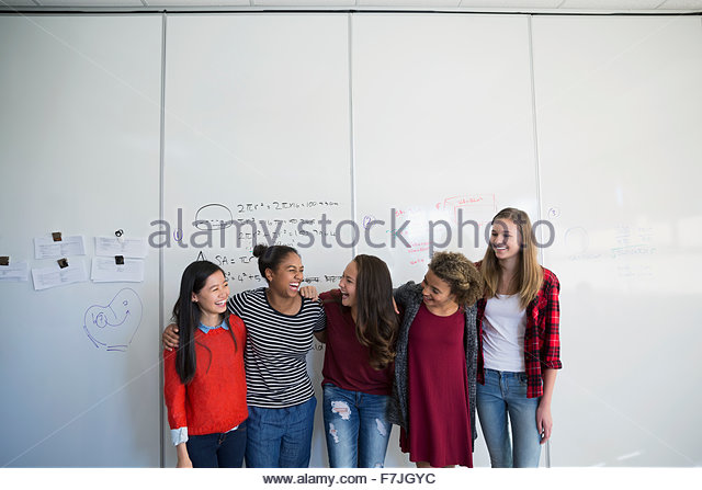 Female high school students a row classroom - Stock Image