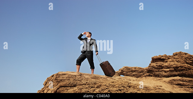 Full length portrait of a lost businessman searching for a way - Stock-Bilder