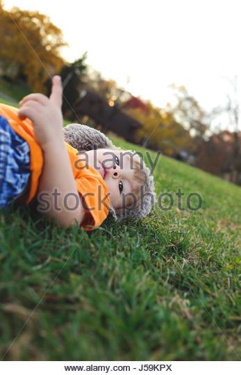 Toddler boy playing outdoors - Stock Image
