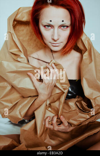 Red haired woman in craft paper - Stock Image