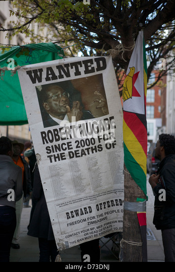 Wanted poster outside Embassy of Zimbabwe in London: Wanted Robert Mugabe - Stock Image