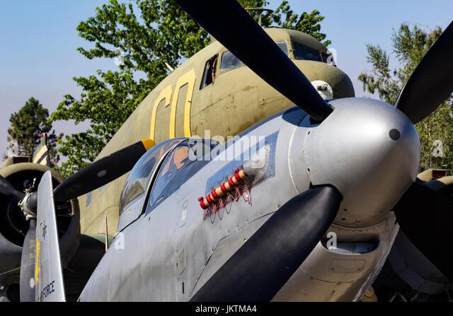 World War II era P-51H Mustang and C-47 Dakota sit on the ramp at Grass Valley, California - Stock Image