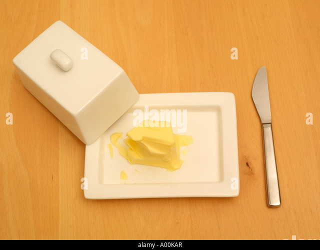 Butter in a Butter Dish and Knife - Stock Image