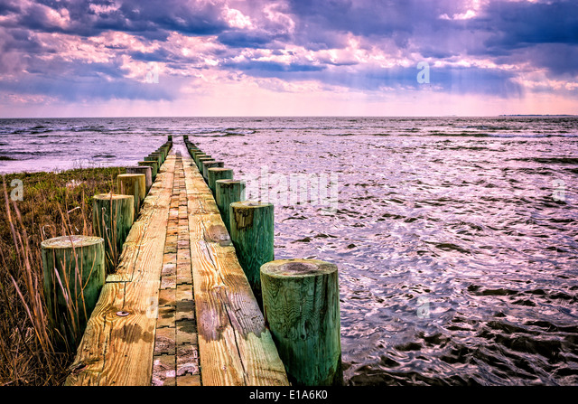 A beautiful sky seen from a jetty at the beach. Old Saybrook, Connecticut - Stock-Bilder