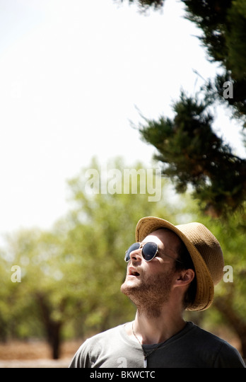 Man with sunglasses and sun hat - Stock Image