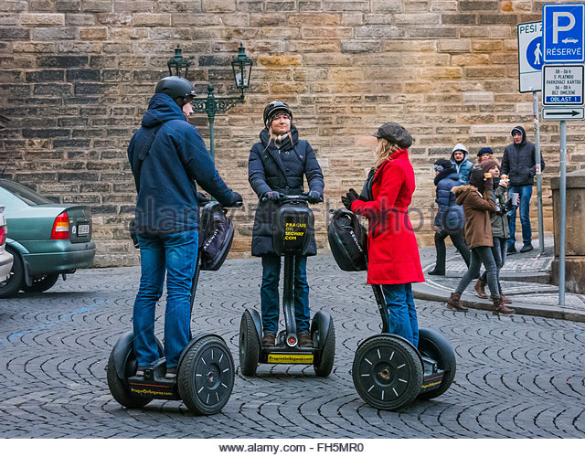 Prague, Czech Republic - 2 January 2014:  Colour image showing tourists taking a break from riding Segways around - Stock Image