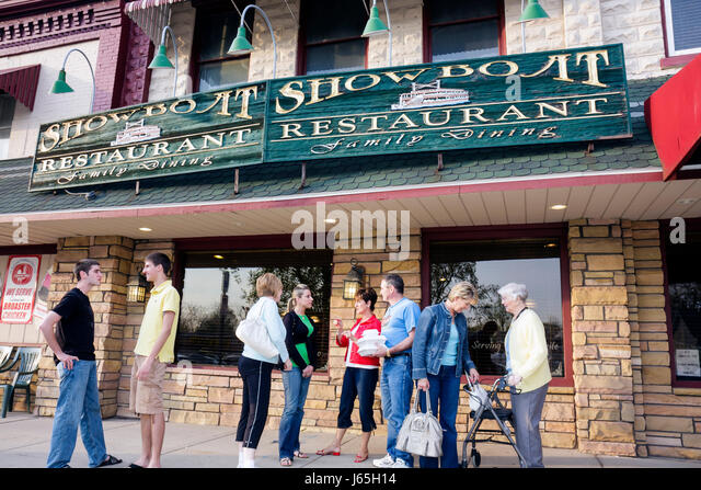 Michigan Chesaning Showboat Restaurant family dining business entrance facade windows customers group man woman - Stock Image