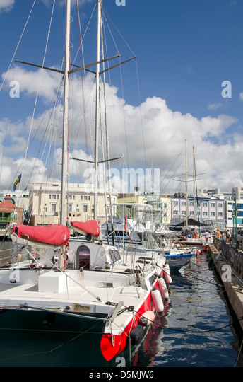 Sailboats and catamarans line the Careenage Marina in Bridgetown, Barbados - Stock Image