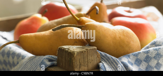 Fresh pears on napkin, close up - Stock Image