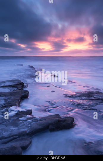 Dramatic sunset above Nash Point on the Glamorgan Heritage Coast, South Wales, Britain. Autumn (October) 2013. - Stock Image