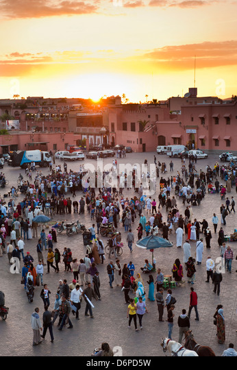 View over people in the Place Djemaa el Fna at sunset, Marrakech, Morocco, North Africa, Africa - Stock Image