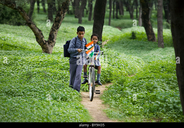 School kids passing through a jungle - Stock-Bilder