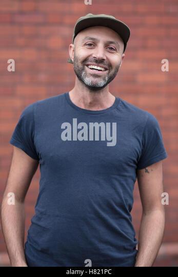 Portrait of a friendly arabic man in his 30s - Stock-Bilder