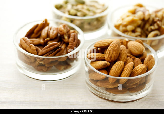 Assortment of nuts in glass containers - Stock Image