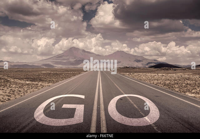go text on the road - Stock-Bilder