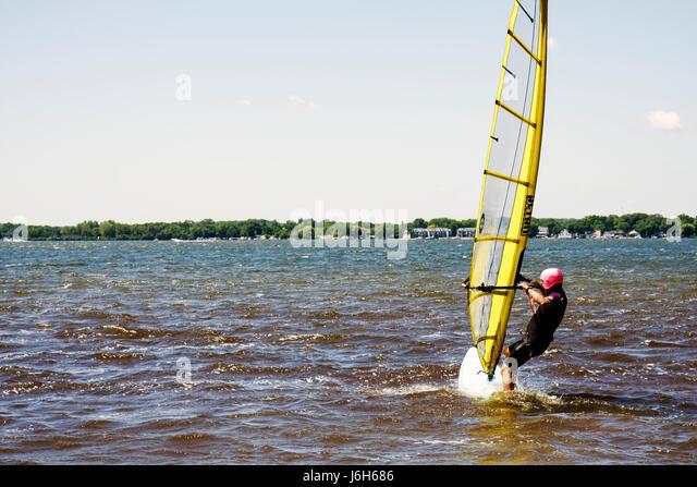 Wisconsin Kenosha Silver Lake Silver Lake Park windsurfing man sail board wetsuit water sport - Stock Image