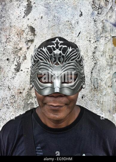 Brazil, Rio de Janeiro, Man in mask at carnival - Stock Image
