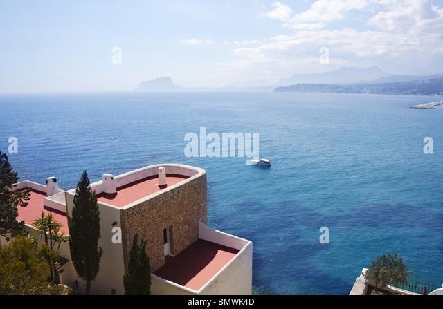 moraira architecture and mediterranean sea in alicante spain - Stock Image