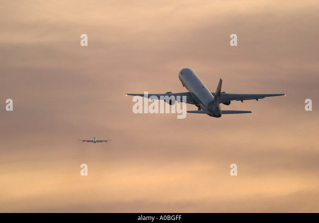 Two aeroplanes climbing out after take off - Stock Image