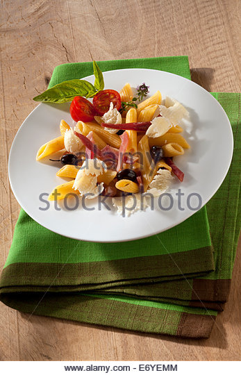 Penne with raw ham and parmesan - Stock Image