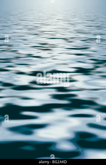 Very gentle soft textured back lit waves - usefull as background - Stock Image
