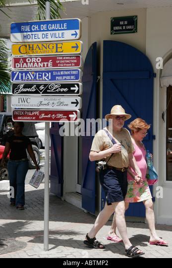Saint Martin French Marigot Rue Charles de Gualle duty free shopping couple - Stock Image