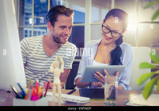 Happy young designers working together - Stock Image