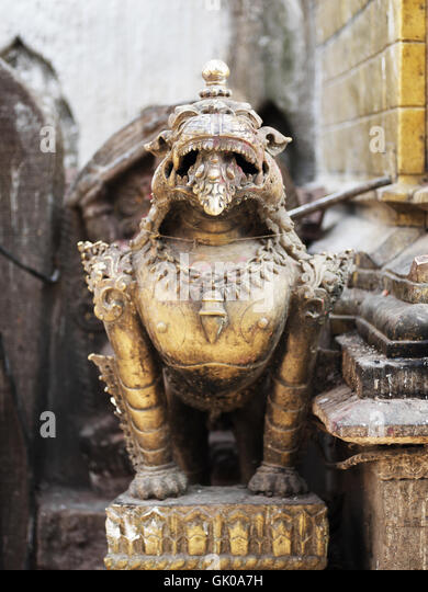 A statue outside a pagoda in Lukla, Nepal. - Stock Image