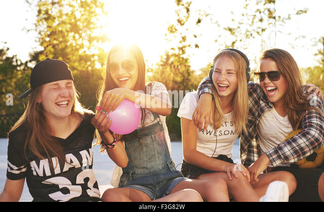Friends having fun outside on a summer day - Stock Image