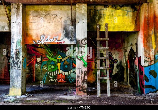 Colorful Graffiti at Abandoned Power Station near Jordan River, Vancouver Island, British Columbia, Canada - Stock Image