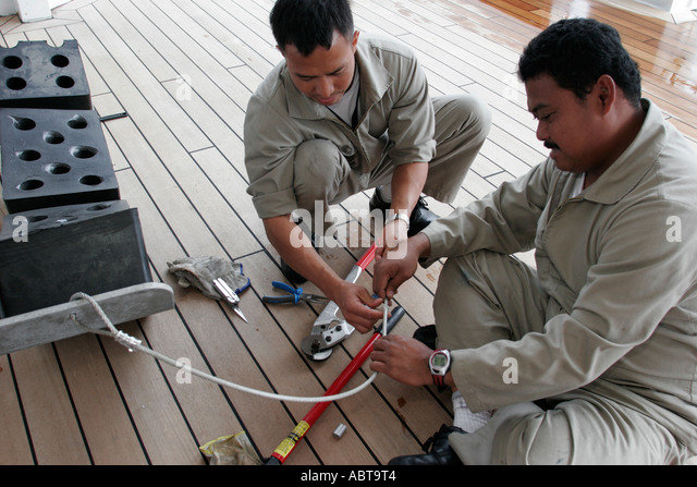 BVI Tortola Holland America Caribbean cruise from New York ms Noordam Asian male mechanic work cable - Stock Image