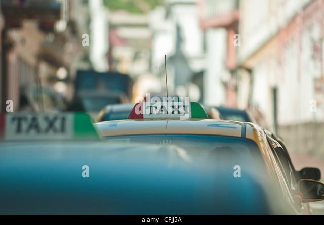 Taxis in historic centre of Quito, Ecuador - Stock Image