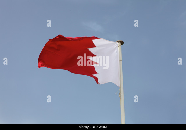 The national flag of the Arabian Gulf state of Bahrain - Stock Image