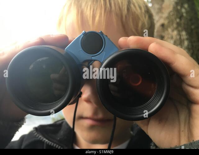Young boy with binoculars - Stock Image