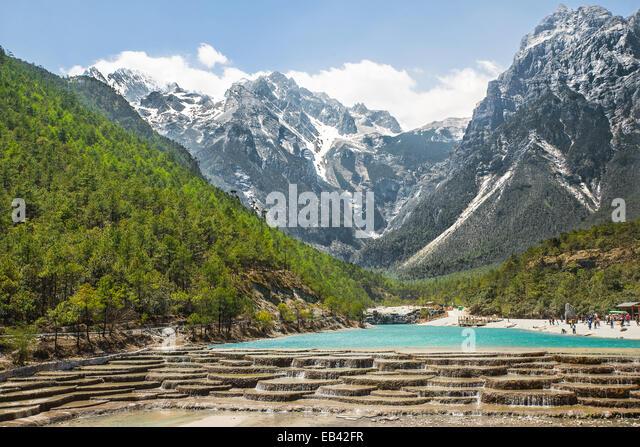 White Water River waterfall and Jade Dragon Snow Mountain, Lijiang, Yunnan China. - Stock Image