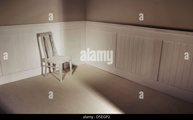 Empty interior with oldfashion chair against wall - Stock Image