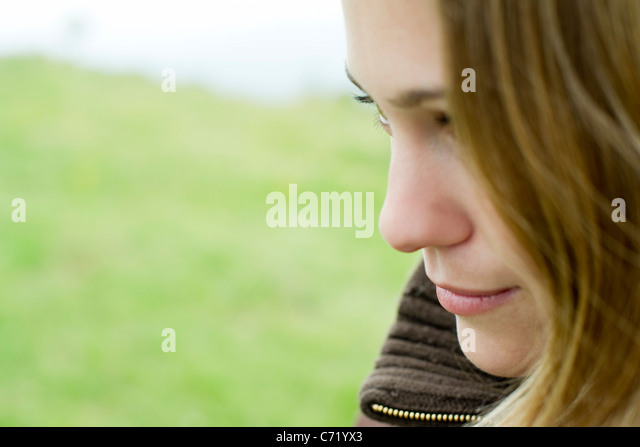 Young woman, side view - Stock Image