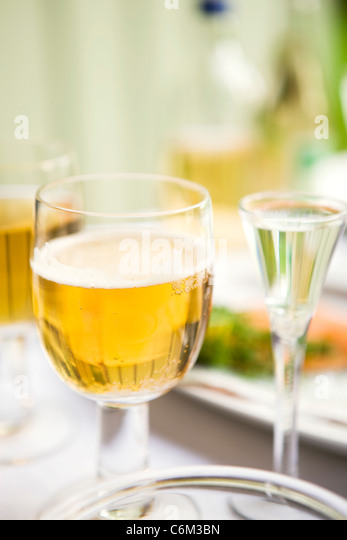 Glass of beer with meal - Stock Image