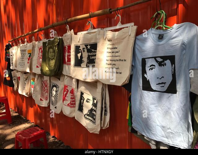 Rangun, Myanmar. 21st Feb, 2017. T-shirts and bags made in fair production can be seen at a tourist market in Rangun, - Stock-Bilder