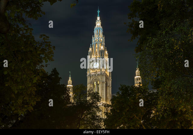 Facade of the town hall or Rathaus illuminated at night in Vienna, Austria - Stock Image