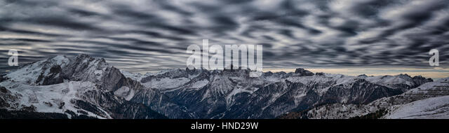 landscape from Sella pass in a winter afternoon and the wind plays with the clouds - Stock Image