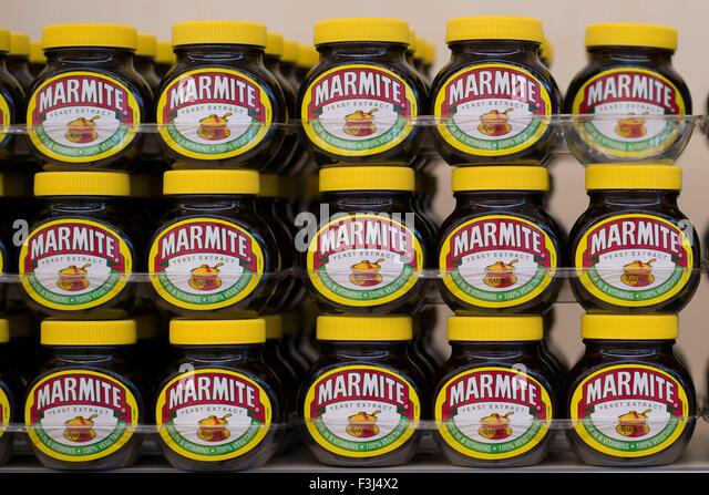 Jars of Marmite on a supermarket shelf - Stock Image